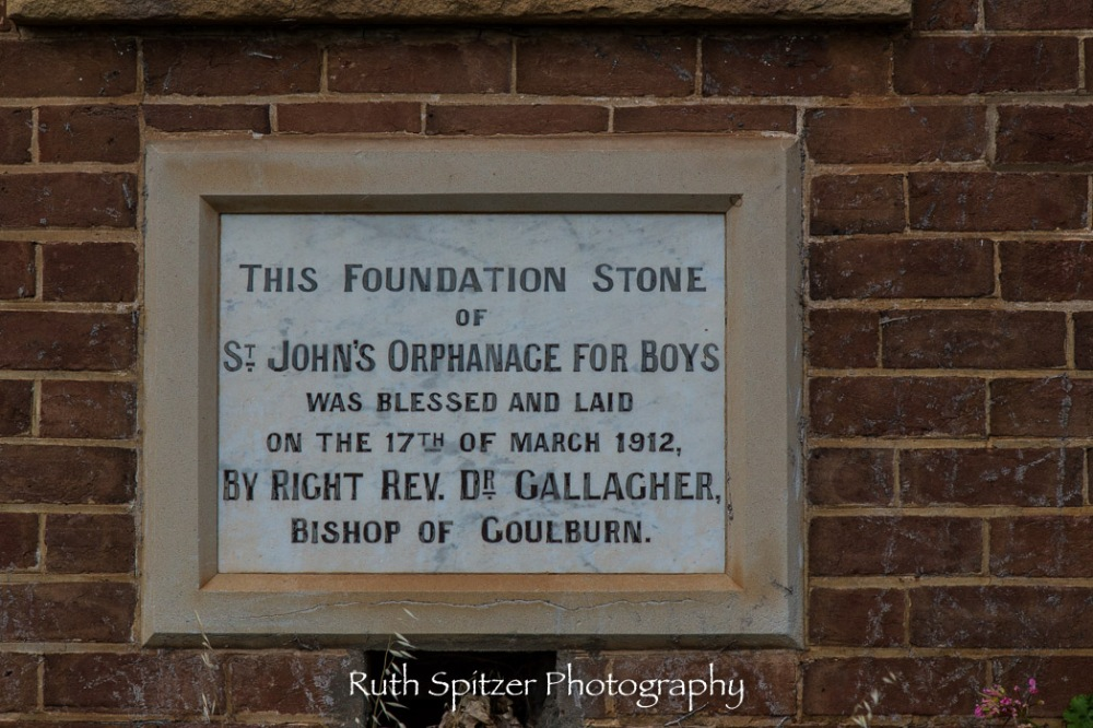 Plaque on the wall of the Abandoned St Johns Orphanage in Goulburn. Image by Ruth Spitzer
